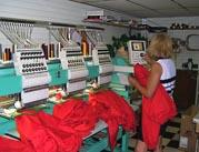 Embroiderer at embroidery machines.